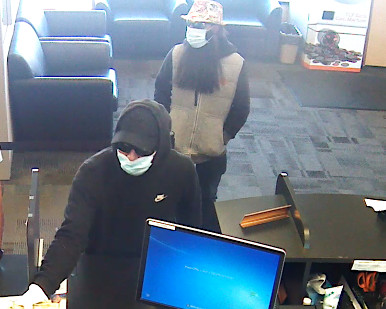 The FBI says this photo shows two men robbing a TCF Bank in Park Ridge on Sept. 18, 2019. | FBI
