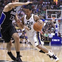 Utah Jazz's Devin Harris, right, drives on Orlando Magic's Ryan Anderson during the second half of an NBA basketball game in Salt Lake City, Saturday, April 21, 2012. The Jazz beat the Magic 117-107 in overtime. (AP photo/George Frey)