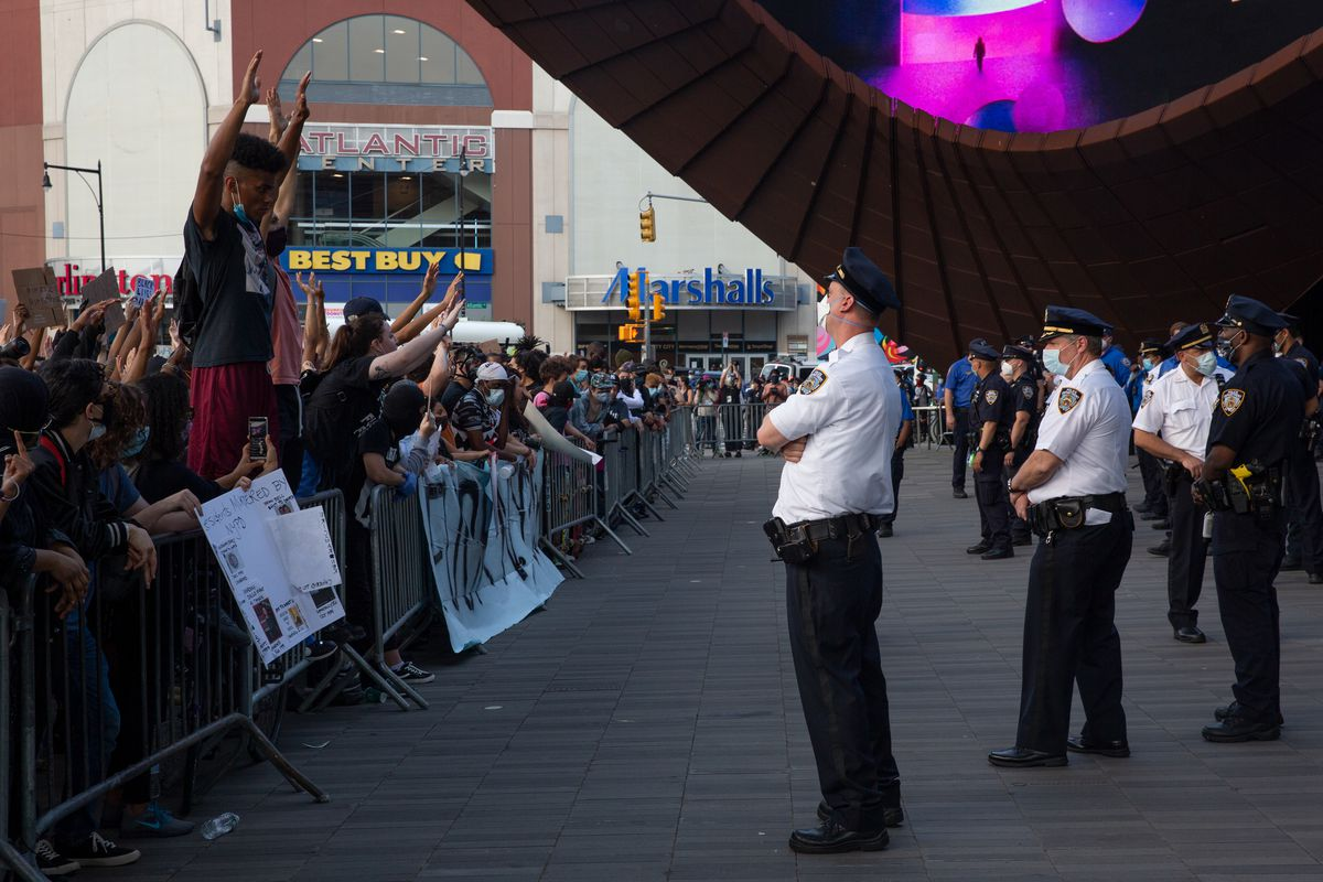 Protesters face off with police at the Barclays Center in late May.