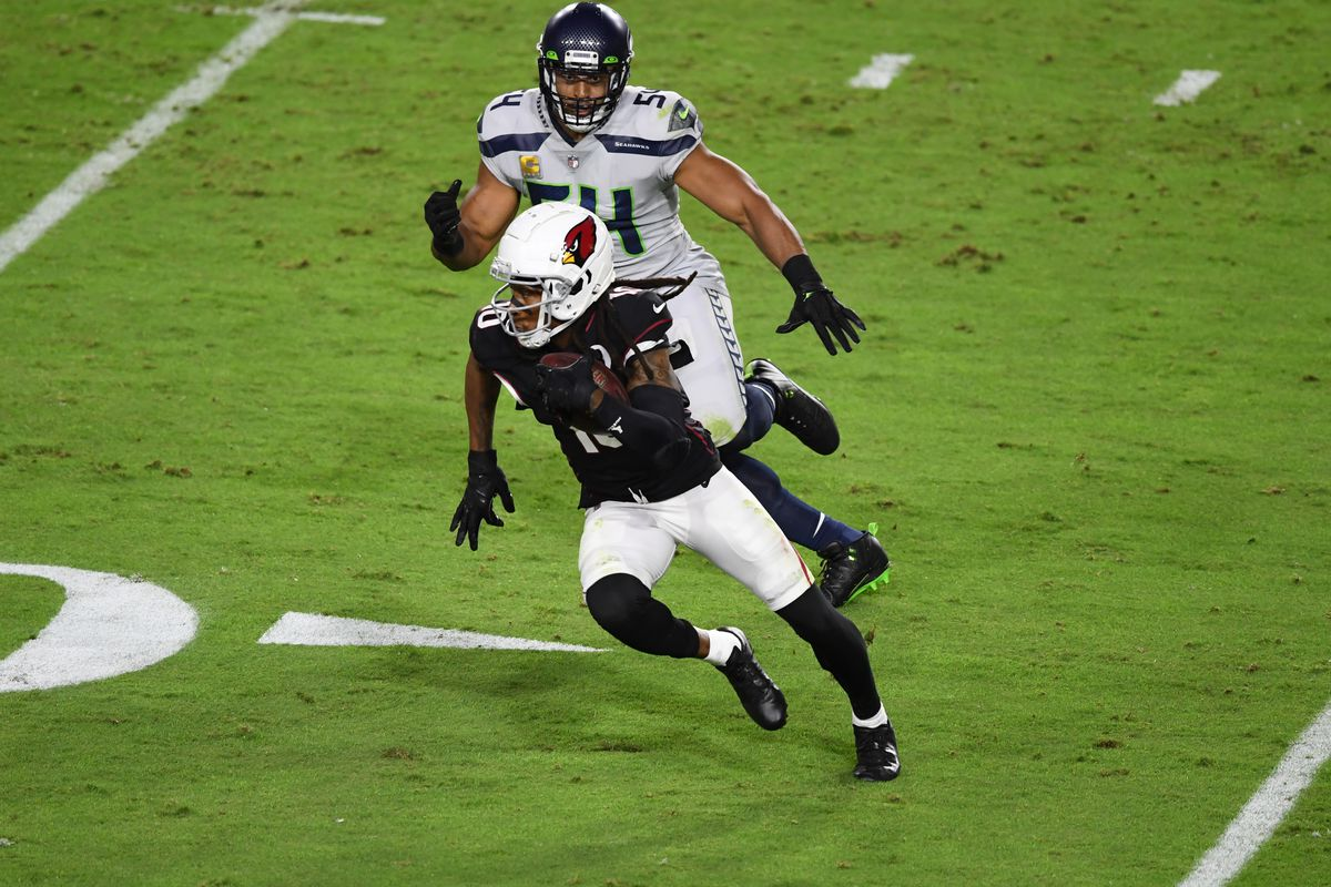 DeAndre Hopkins #10 of the Arizona Cardinals runs with the ball against the Seattle Seahawks at State Farm Stadium on October 25, 2020 in Glendale, Arizona.