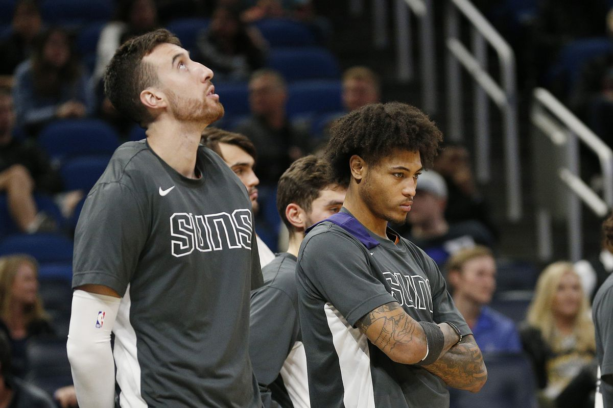 Frank Kaminsky and Kelly Oubre Jr. of the Phoenix Suns react on the bench against the Orlando Magic during the second half at Amway Center on December 04, 2019 in Orlando, Florida.