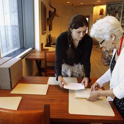In this Sept. 11, 2012, photo Hemingway curator Susan Wrynn, right, and intern Jessica Green collate documents from the Hemingway collection at the John F. Kennedy Library and Museum in Boston. Among letters written to Ernest Hemingway slated for repair are dispatches from public figures including Hollywood stars Ingrid Bergman and Marlene Dietrich, writers F. Scott Fitzgerald and Gertrude Stein, and Hemingway's editor Max Perkins.