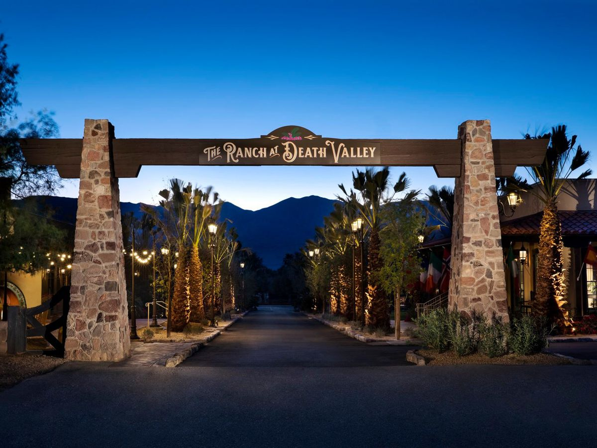 Gateway to desert resort with signage reading The Ranch at Death Valley
