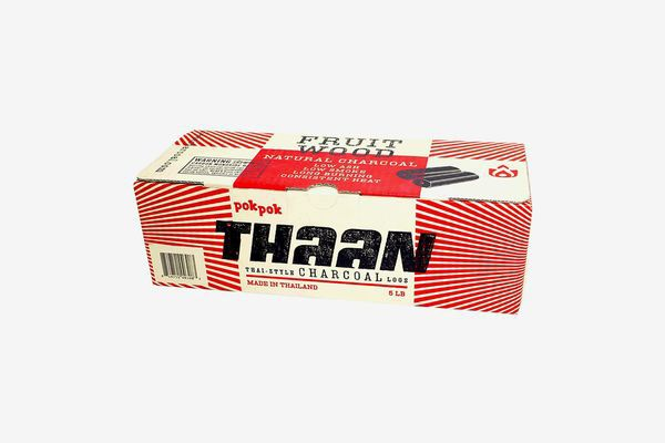 A box of Thaan charcoal logs on a white background