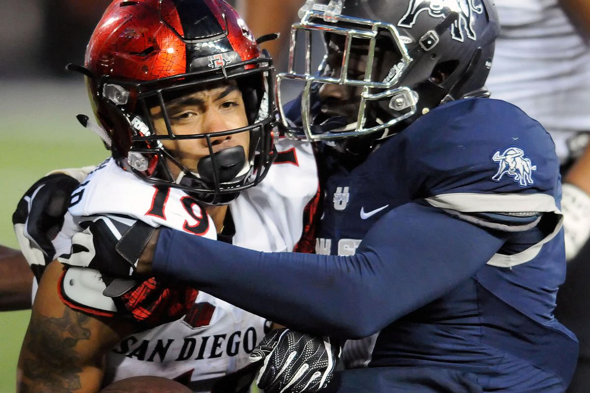 San Diego State running back Donnel Pumphrey (19) is tackled by Utah State cornerback Daniel Gray (7) during an NCAA college football game Friday, Oct. 28, 2016, in Logan, Utah.