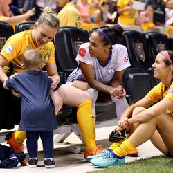 Utah Royals FC forward Amy Rodriguez (8) helps her son Luke as she talks with Orlando forward Sydney Leroux (2) and teammate Utah Royals FC midfielder Erika Tymrak (15) after a match against the Orlando Pride at Rio Tinto Stadium in Sandy on Wednesday, May 9, 2018.