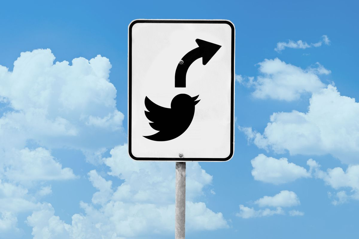 A picture of a road sign with the Twitter logo and an arrow pointing up