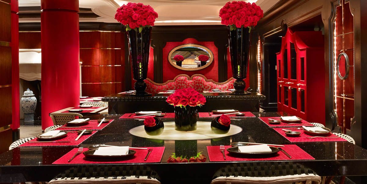 Restaurant interior with dim lighting and red decor