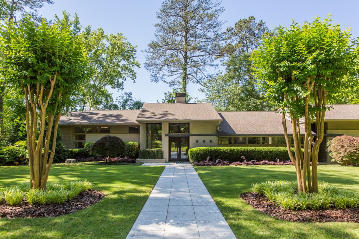 A renovated midcentury modern house for sale in Buckhead's Pine hills.