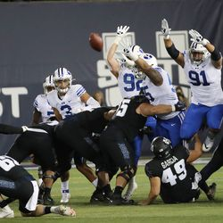 Utah State Aggies place kicker Connor Coles (59) kicks a field goal in Logan on Friday, Oct. 1, 2021.
