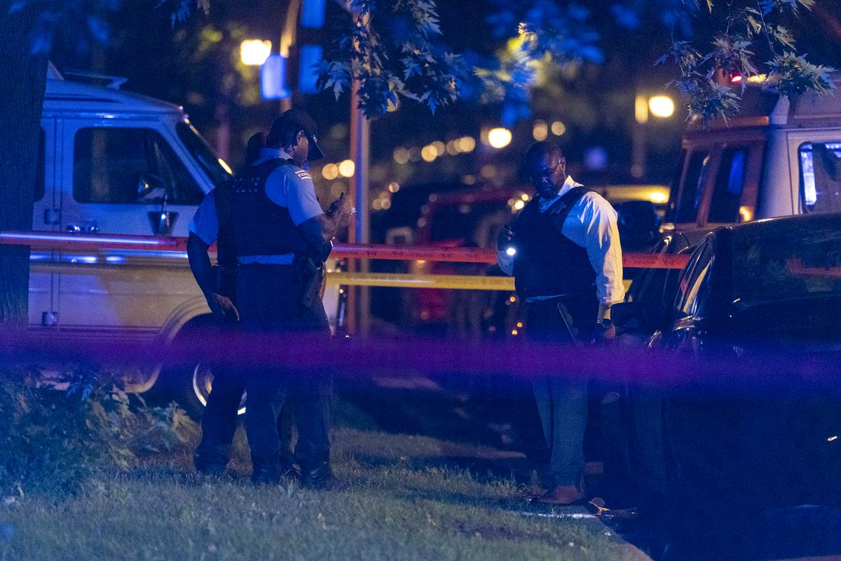 Chicago police work the scene where four people were shot in the 7000 block of South Indiana Ave, in the Park Manor neighborhood, Saturday, June 26, 2021.   Tyler LaRiviere/Sun-Times