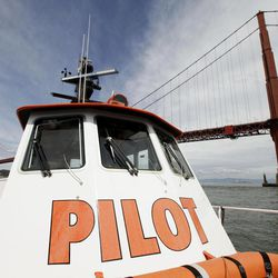 In this photo taken Wednesday April 25, 2012, a San Francisco Bar Pilot boat makes its way past the Golden Gate Bridge in San Francisco. Since the days of Mark Twain, the pilots have had it good. Thanks to political clout and highly specialized training, this cadre of 60 ship captains has for more than a century had control over guiding oil tankers and cargo ships in, out and around the San Francisco Bay.
