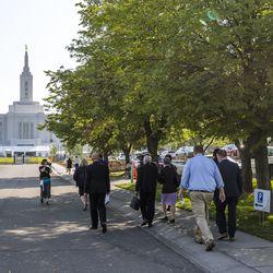 Members of the mediawalk towardThe Church of Jesus Christ of Latter-day Saints'Pocatello Idaho Temple in Pocatello, Idaho, on Monday, Sept. 13, 2021.