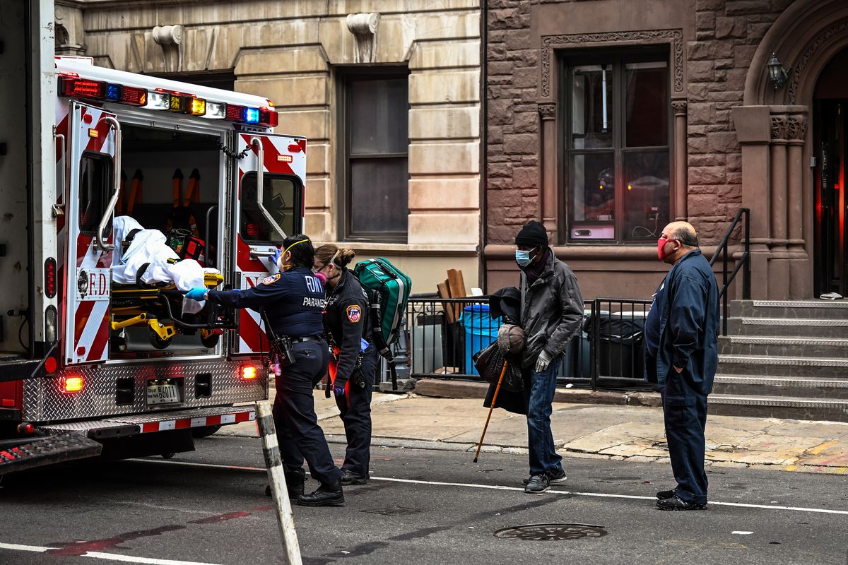 Paramedics load a patient into an ambulance in the East Village, Dec. 4, 2020.