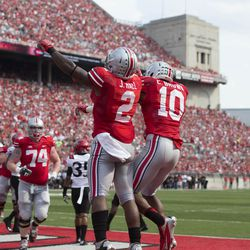 """Jordan Hall and Corey """"Philly"""" Brown celebrate a score."""