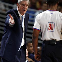 Utah Jazz head coach Jerry Sloan, left, argues a call with referee Tony Brown in the first quarter of an NBA basketball game against the Denver Nuggets in Denver on Sunday, Jan. 25, 2009.