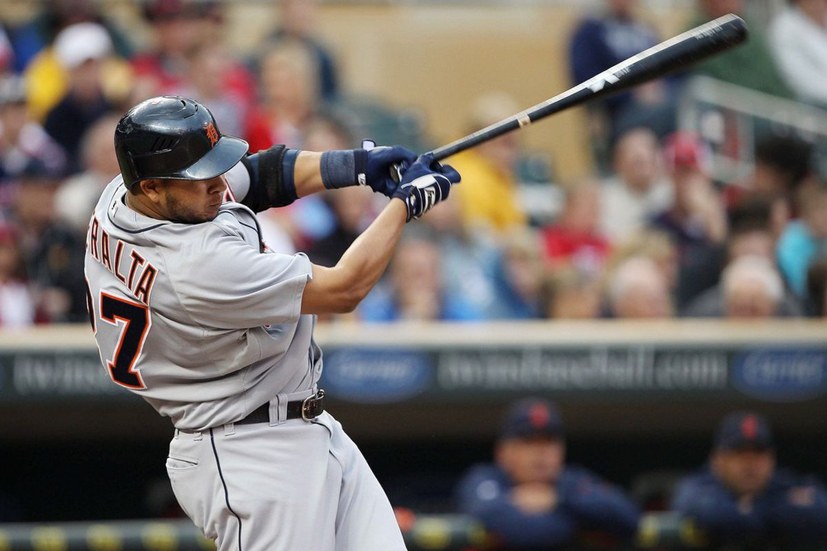 May 26, 2012; Minneapolis, MN, USA: Detroit Tigers shortstop Jhonny Peralta (27) hits a single in the sixth inning against the Minnesota Twins at Target Field. Mandatory Credit: Jesse Johnson-US PRESSWIRE