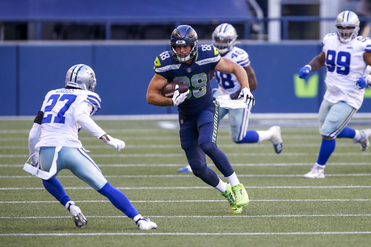Seattle Seahawks tight end Greg Olsen (88) runs for yards after the catch against the Dallas Cowboys during the fourth quarter at CenturyLink Field.