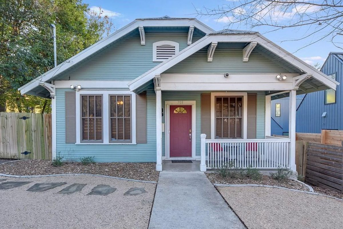Small wood-frame house painted blue