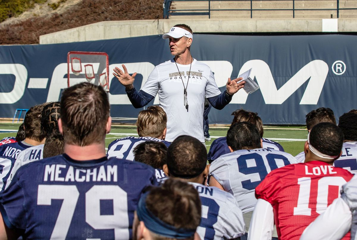 Utah State head football coach Gary Andersen talks to his team at the end of scrimmage Saturday, March 30, 2019, at Maverik Stadium in Logan.