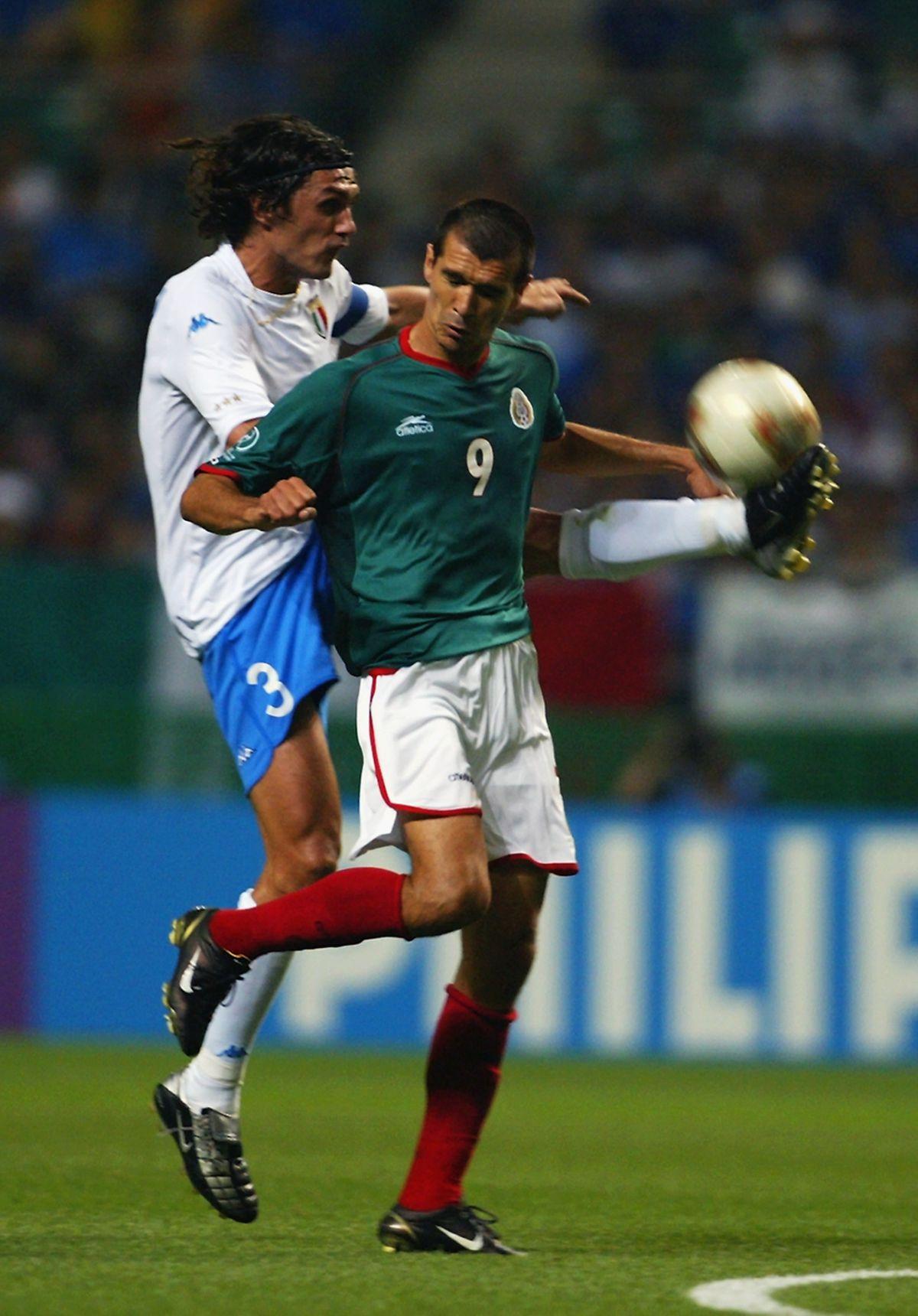 Jared Borgetti of Mexico and Paolo Maldini of Italy