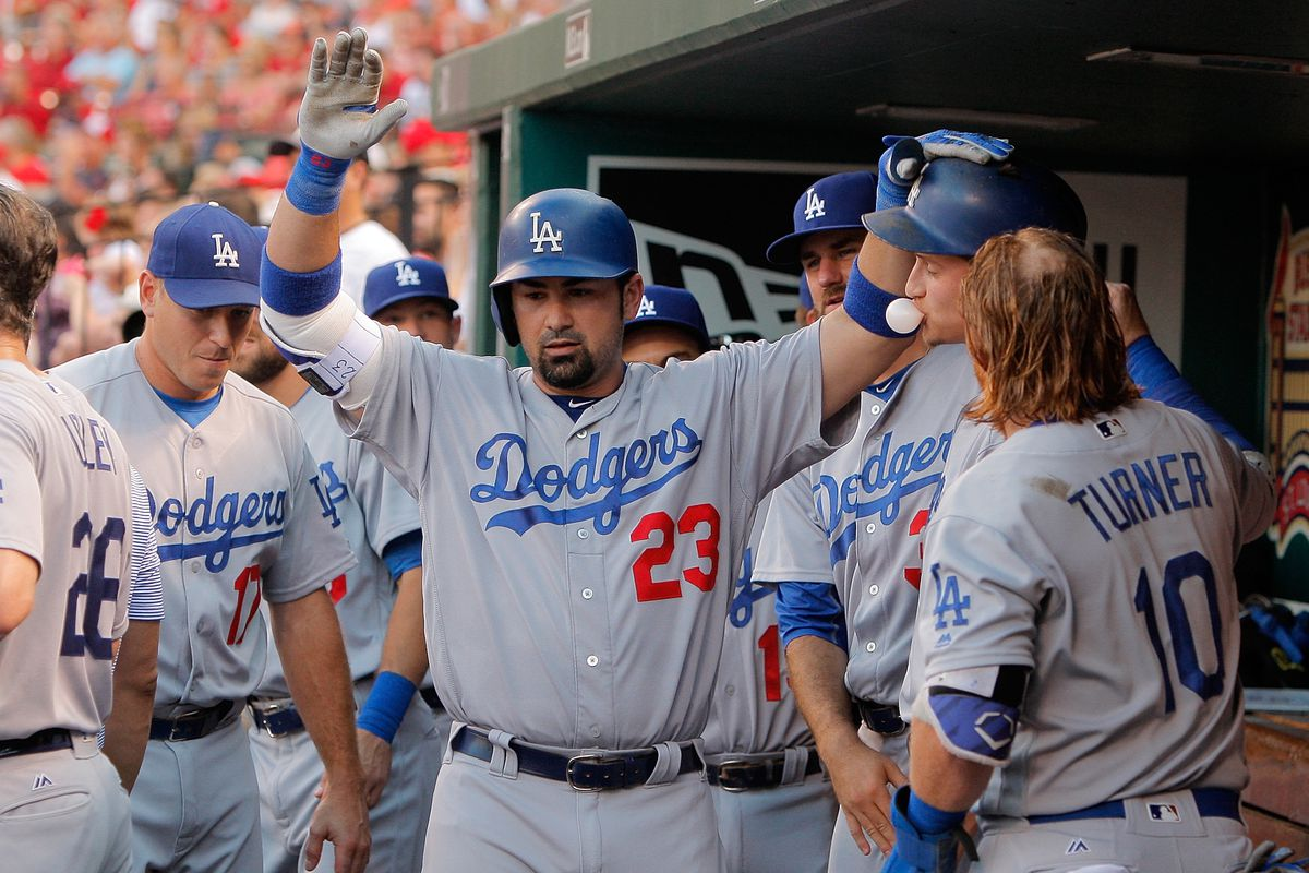 Adrian Gonzalez celebrates his grand slam in the first inning on Sunday night.