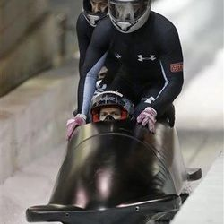 From front to back, Cory Butner, Chuck Berkeley, Andreas Drbal and Chris Langton come to a stop after racing in the United States four-man bobsled team trials on Saturday, Oct. 26, 2013, in Park City, Utah. Butner and his crew came in third place. (AP Photo/Rick Bowmer)