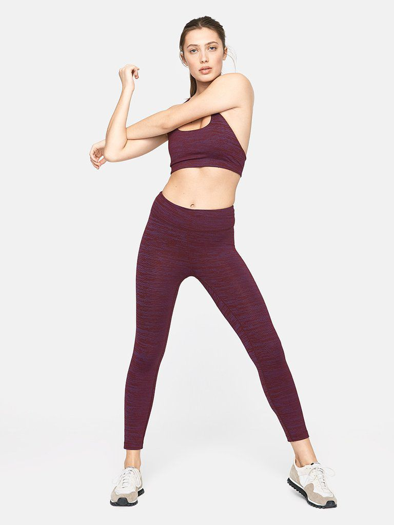 A woman in burgundy workout clothes