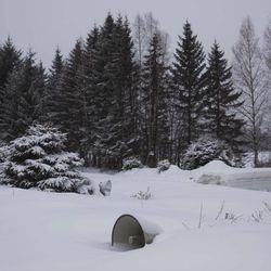 In this Tuesday, April 3, 2012 photo, deep snow blankets a loud speaker used to broadcast propaganda at Samjiyon Grand Monument area in Samjiyon, North Korea where a large bronze statue of the late North Korean leader Kim Il Sung stands at the base of Mount Paektu. The story of Mount Paektu is the story of how one man managed to build an entire national culture and history around his own carefully crafted story, deliberately drawing on the methods and symbols of religion.