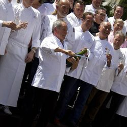 Wolfgang Puck at the saber off. Photo by Chelsea McManus