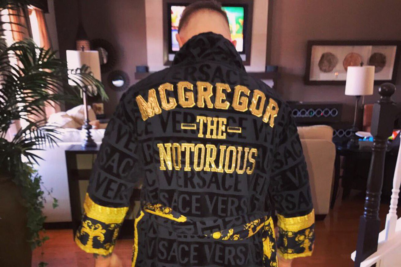 community news, Conor McGregor flaunts custom Versace robe