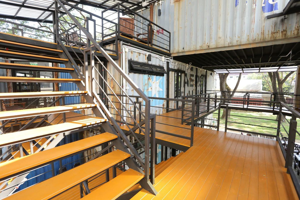 Platforms and stairs leading to shipping containers