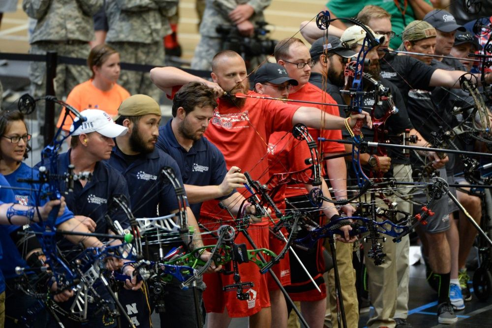 Marine Corps veteran Clayton McDaniel aims his bow in a line of archers competing in last year's Department of Defense Warrior Games at the U.S. Military Academy in West Point, N.Y. on June 17, 2016. | Roger Wollenberg / Defense Department