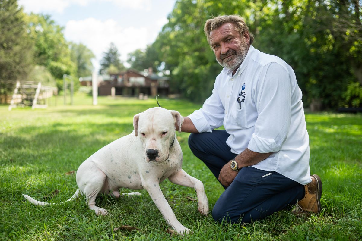 Joe Petit with his dog Philotimo in his back yard in Wayne, Ill., Wednesday morning, Sept. 1, 2021.