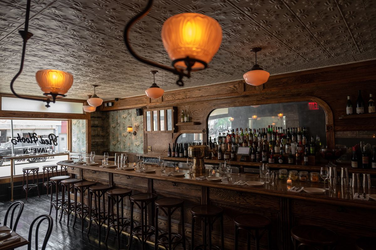 Light pours in through the windows at Red Hook Tavern's bar room, which sits empty before service
