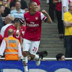 Arsenal's Kieran Gibbs celebrates after his cross is deflected into the Southampton goal during their English Premier League soccer match at the Emirates stadium, London, Saturday, Sept. 15, 2012.
