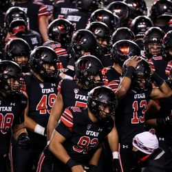 Utah Utes players gather on the field before the game between the Utah Utes and the USC Trojans at Rice-Eccles Stadium in Salt Lake City on Saturday, Nov. 21, 2020.