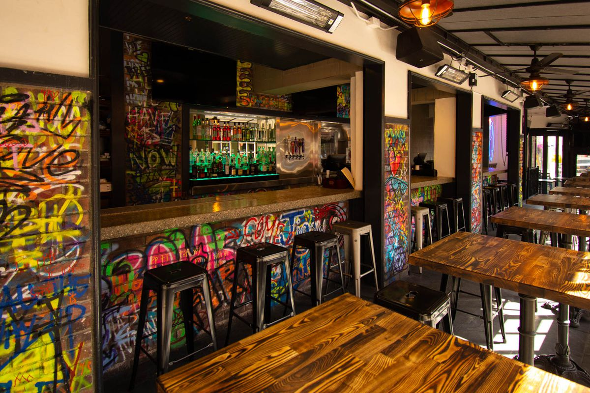 Graffiti-covered bar and burger hangout restaurant in Hollywood.