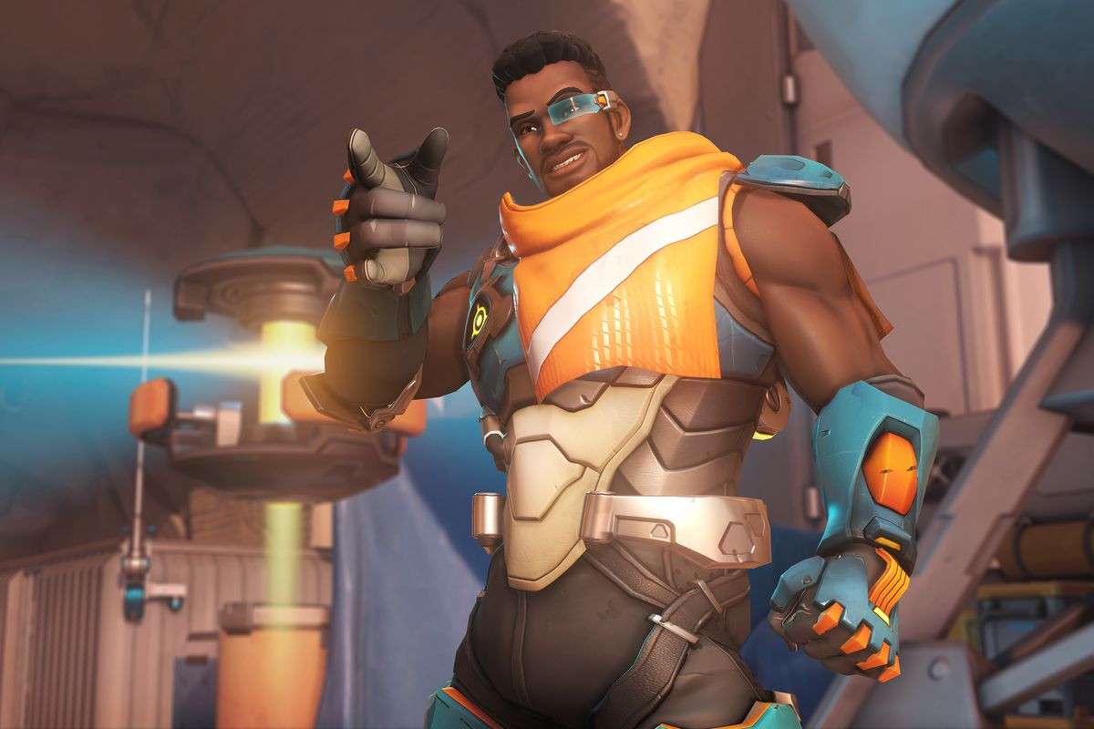 Baptiste smiles and points in a screenshot from Overwatch
