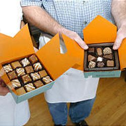 Chocolates are placed in various-size boxes.