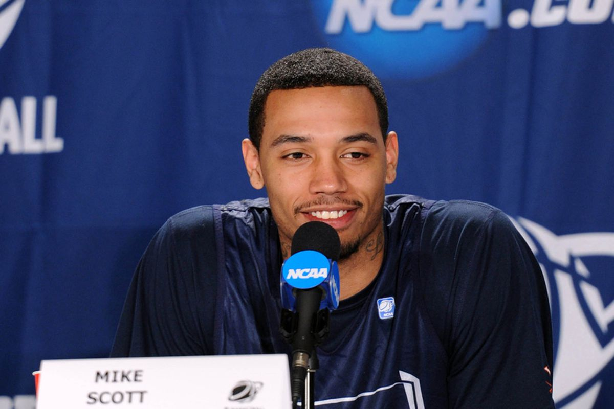 Virginia's Mike Scott is predicted to go as high as the middle of the second round. Will he be able to improve his stock by draft time? (Peter G. Aiken-US PRESSWIRE)