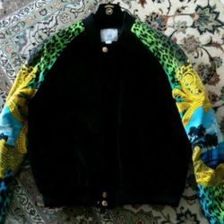"""This jacket is <a href=""""http://www.ebay.com/itm/Versace-H-M-Mens-Velvet-Jacket-SIZE-L-Kanye-West-/220896439350?pt=US_CSA_MC_Outerwear&hash=item336e742c36"""" rel=""""nofollow"""">advertised as the Kanye jacket</a>, and while he wore one that looked like this t"""