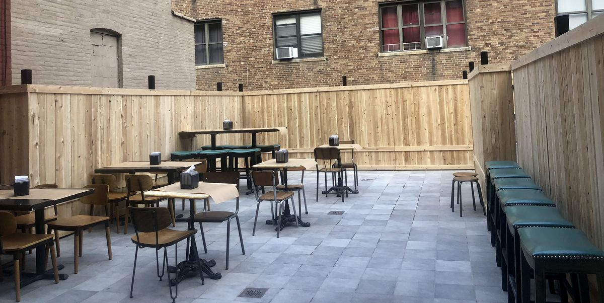 The outdoor patio with chairs and tables at Miznon North