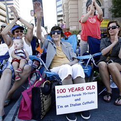 Della Pantos, 100, center, watches the Days of '47 Parade with her daughter Patti Jones, left, her great-grand niece Lillie Bell Foust, 1, and niece Debbie Thornton, right, in downtown Salt Lake City on Saturday.