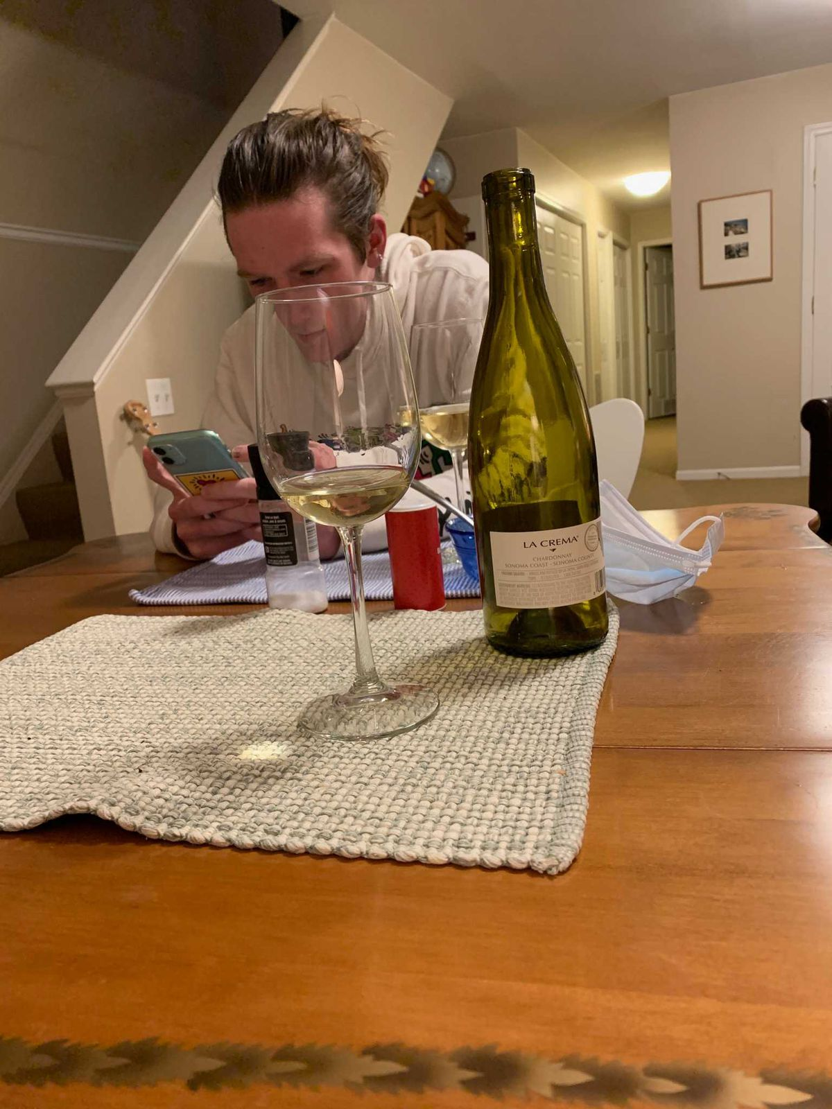 Jack Siebert sits across from his mom, Kate, as they have dinner together while quarantined.