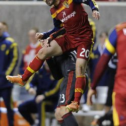 Real Salt Lake midfielder Ned Grabavoy (20) heads the ball over Toronto FC midfielder Alvaro Rey (23) during a game at Rio Tinto Stadium in Sandy on Saturday, March 29, 2014.