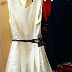 Flared dress in cream with black patent belt.