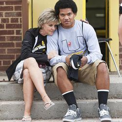 Debby Arnold talks with Union High School football player Paul Kaufusi Wednesday, Sept. 25, 2013. Some players were told they wouldn't be playing in Friday's homecoming game. The football coaches at Union High in Roosevelt have taken a stand against poor performance in the classroom and bullying outside the classroom, including disrespect of teachers and students.