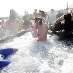 After plunging into the cold water of Utah Lake, participants warm up in a hot tub Saturday. A couple hundred people showed up to take part in and also to watch the second Polar Plunge in Saratoga Springs.