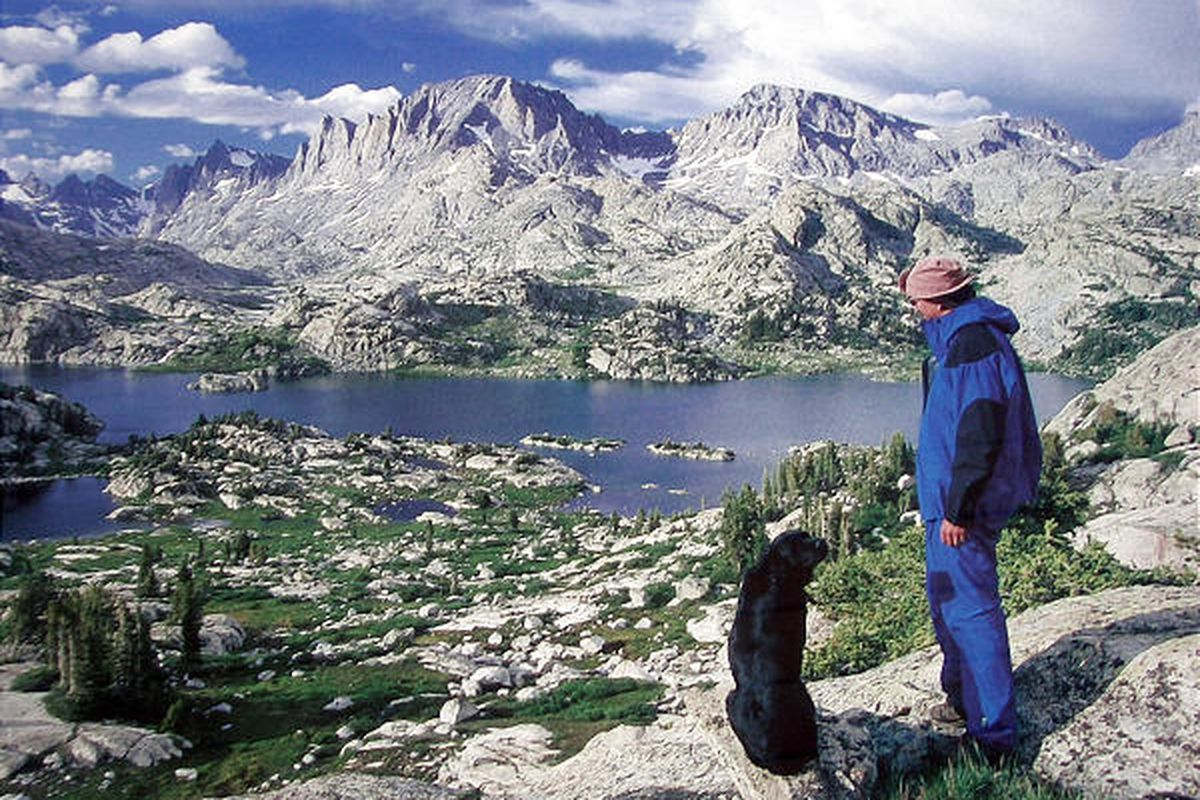In this 1998 self-portrait, the Rev. Mike Turner stands with his dog, Andy, in the Fitzpatrick Wilderness in Shoshone National Forest in Wyoming. The Idaho pastor died while on a hiking trip 10 years ago.